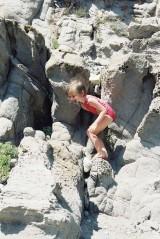 Alix in the rocks of Capo Sandalo on San Pietro Island in Sardinia, view 2, July 2001