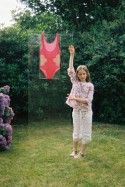 Alix in the garden in Brest and the worn bathing suit, view 1