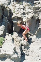 Alix in the rocks of Capo Sandalo on San Pietro Island in Sardinia, view 2, July 2001