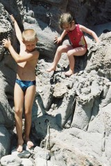 Alix and her brother in the rocks of Capo Sandalo on San Pietro Island in Sardinia, view 3, July 2001